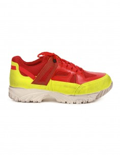 """Security"" red and yellow sneakers with retro style"