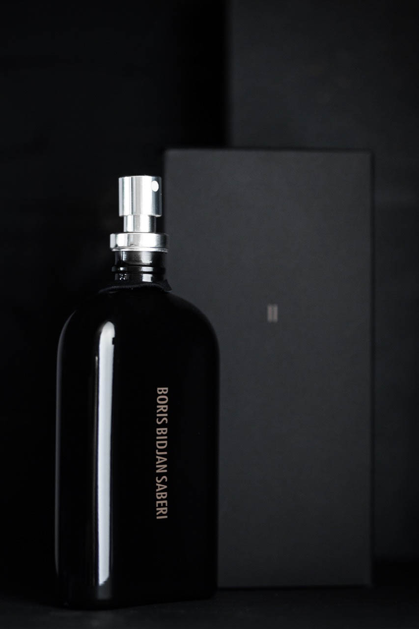 This month the Barcelona-based designer Boris Bidjan Saberi launched his first fragrance. Saberi is best knows for his intricately constructed leather jackets, and it was no surprise to learn that the fragrance is inspired by the smell of vegetable tanned leather. Saberi also wanted the fragrance to reflect the sensory imprint of his daily work routine, the scents of raw materials that surround him in his atelier that at the end of the day mix with the odors unique to his body. This is how Saberi thinks of his work; each product he produces inevitably contains a part of himself as a designer and artisan.